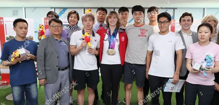 Stock Photo of Katie Ledecky (C) of the United States, who won gold in the women's 800m freestyle finals at the 2019 FINA World Championships in Gwangju, 330 kilometers south of Seoul, poses with swimmers with developmental disorders at the Special Olympics Korea building in Seoul, South Korea, 30 July 2019.