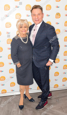 Judith Chalmers and Richard Arnold