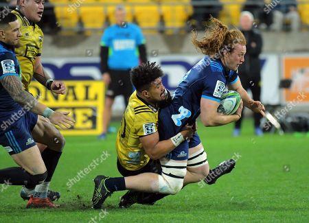 Stock Photo of Ardie Savea tackles Tom Robinson