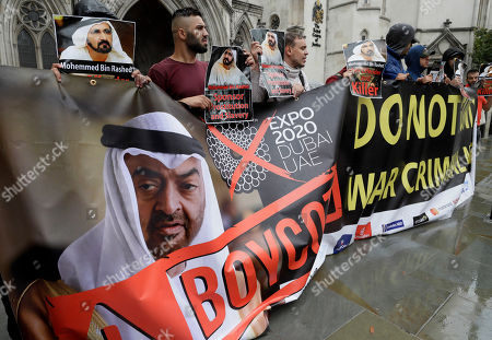 Demonstrators hold banners as they demonstrate against Sheikh Mohammed bin Rashid al-Maktoum outside The High Court in London, . Sheikh Mohammed bin Rashid al-Maktoum has made an application to divorce his wife of 15 years, Princess Haya Bint al-Hussein, in the Family Court Division of the High Court