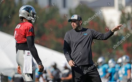 Carolina Panthers quarterbacks coach Scott Turner, right, talks with Cam Newton (1) during practice at the NFL football team's training camp in Spartanburg, S.C