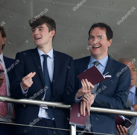 George Osborne watches the racing on the opening day.