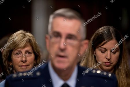 Stock Photo of John Hyten, Laura Hyten. Gen. John Hyten, foreground, accompanied by his wife Laura, left, and his daughter Katie, right, appears before a Senate Armed Services Committee on Capitol Hill in Washington, for his confirmation hearing to be Vice Chairman of the Joint Chiefs of Staff