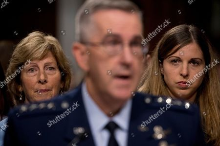 Stock Image of John Hyten, Laura Hyten. Gen. John Hyten, foreground, accompanied by his wife Laura, left, and his daughter Katie, right, appears before a Senate Armed Services Committee on Capitol Hill in Washington, for his confirmation hearing to be Vice Chairman of the Joint Chiefs of Staff