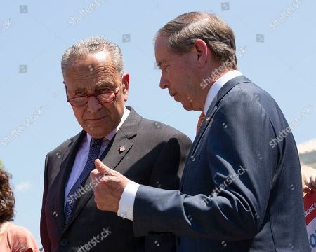 United States Senate Minority Leader Chuck Schumer (Democrat of New York) speaks to United States Senator Tom Udall (Democrat of New Mexico) during a press conference outside of the Supreme Court in Washington D.C.