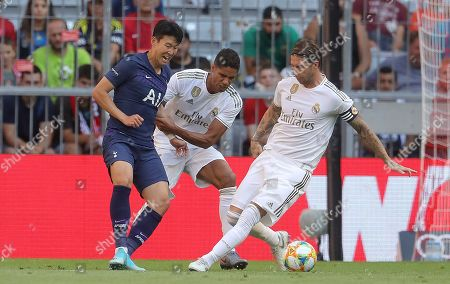 Son Heung-Min of Tottenham Hotspur battles with Sergio Ramos and Raphael Varane of Real Madrid