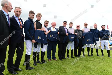 Stock Image of GALWAY. Leading Flat and National Hunt jockeys to wear new Comer Group International racing breeches for the first time in support of Comer Group International free career-ending insurance for jockeys. (L-R)Billy Comer, ANdrew Coonan, Bryan Cooper, David MUllins, Leigh Roche, Brian Comer, Luke Comer, Paul Townend, John Comer, Davy Russell, Robert Power and Sean Flanagan.