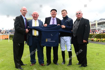Stock Photo of GALWAY. Leading Flat and National Hunt jockeys to wear new Comer Group International racing breeches for the first time in support of Comer Group International free career-ending insurance for jockeys.(L-R) Billy Comer, Brian Comer, Luke Comer, Paul Townend and John Comer.