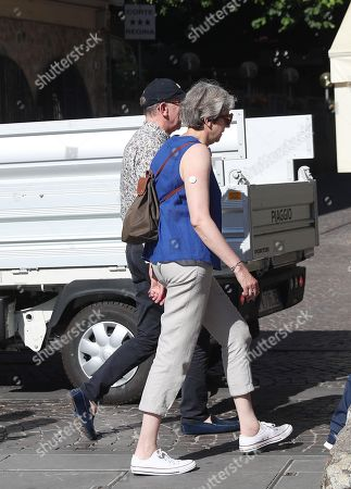 Stock Photo of British former Prime Minister Theresa May and her husband Philip May walk in Sirmione (Brescia), Ialy, 30 July 2019.