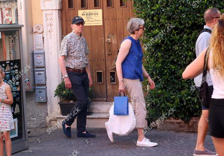 British former Prime Minister Theresa May (C) and her husband Philip May (L) walk in Sirmione (Brescia), Ialy, 30 July 2019.