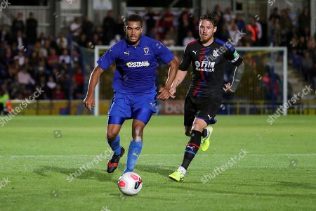 AFC Wimbledon defender Reuben Collins (36) dribbling past Crystal Palace Connor Wickham (21) during the Pre-Season Friendly match between AFC Wimbledon and Crystal Palace at the Cherry Red Records Stadium, Kingston