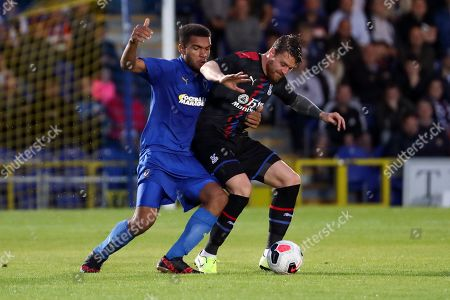 AFC Wimbledon defender Reuben Collins (36) battles for possession with Crystal Palace Connor Wickham (21) during the Pre-Season Friendly match between AFC Wimbledon and Crystal Palace at the Cherry Red Records Stadium, Kingston