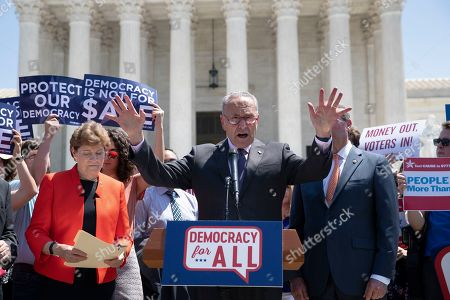 Chuck Schumer, Jeanne Shaheen. Senate Minority Leader Chuck Schumer, D-N.Y., joined at left by Sen. Jeanne Shaheen, D-N.H., leads a group of Democrats at the Supreme Court in announcing the introduction of a constitutional amendment that would overturn Citizens United v. FEC decision to get big money out of politics, at the Supreme Court in Washington