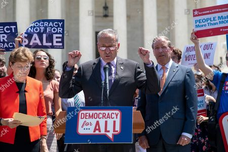 Chuck Schumer, Tom Udall, Jeanne Shaheen. Senate Minority Leader Chuck Schumer, D-N.Y., flanked by Sen. Jeanne Shaheen, D-N.H., left, and Sen. Tom Udall, D-N.M., leads a group of Democrats at the Supreme Court in announcing the introduction of a constitutional amendment that would overturn Citizens United v. FEC decision to get big money out of politics, at the Supreme Court in Washington