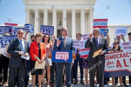 Chuck Schumer, Tom Udall, Jeanne Shaheen, Dick Durbin. Democratic senators, from left, Sen. Dick Durbin, D-Ill., Sen. Jeanne Shaheen, D-N.H., Sen. Tom Udall, D-N.M., and Senate Minority Leader Chuck Schumer, D-N.Y., announce the introduction of a constitutional amendment that would overturn Citizens United v. FEC decision to get big money out of politics, at the Supreme Court in Washington