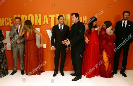 From left, actors Damian Lewis, Margot Robbie, Leonardo DiCaprio, director Quentin Tarantino, his wife Daniela Pick and actors Lena Dunham and Costa Ronin pose for photographers upon arrival at the UK premiere for Once Upon A Time in Hollywood, at a central London cinema