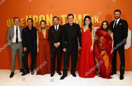 From left, actors Damian Lewis, Brad Pitt, Margot Robbie, Leonardo DiCaprio, director Quentin Tarantino and his wife Daniela Pick, and actors Lena Dunham and Costa Ronin pose for photographers upon arrival at the UK premiere for Once Upon A Time in Hollywood, at a central London cinema