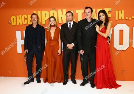 From left, actors Brad Pitt, Margot Robbie, Leonardo DiCaprio, director Quentin Tarantino and his wife Daniela Pick pose for photographers upon arrival at the UK premiere for Once Upon A Time in Hollywood, at a central London cinema