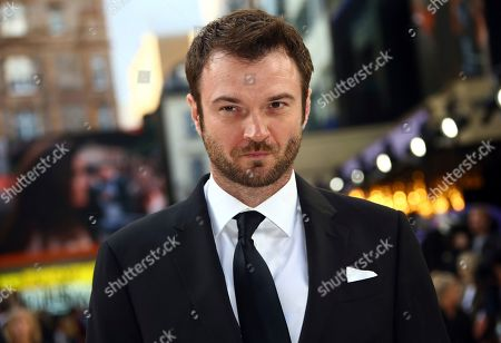 Costa Ronin poses for photographers upon arrival at the UK premiere for Once Upon A Time in Hollywood, at a central London cinema