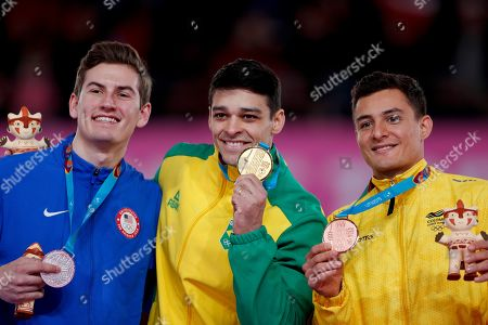 From left to right, silver medalist Robert Neff of United States, gold medalist Francisco Barretto of Brazil and bronze medalist Carlos Calvo of Colombia, stand at the podium for the men's pommel horse artistic gymnastics at the Pan American Games in Lima, Peru