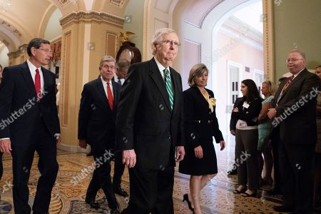 US Senate Majority Leader Republican Mitch McConnell (C) walks up with Republican Senator from Wyoming John Barrasso (L), Republican Senator from Missouri Roy Blunt (Back C) and Republican Senator from Iowa Joni Ernst (R), to hold a news conference on Capitol Hill in Washington, DC, USA, 30 July 2019. The Senate is expected to vote this week before leaving for August recess on a two-year budget plan that would increase spending by 320 billion USD and suspend the federal borrowing limit for two years.