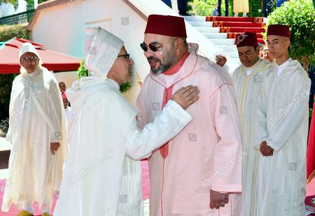 In this photo provided by the Moroccan Royal Palace, Morocco's King Mohammed VI, center, attends a ceremony at the Royal Palace in Tetouan, Morocco,, as part of the 'Day of the Throne' ceremonies, the 20th anniversary of the King's accession to the Throne