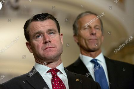 United States Senator Todd Young (Republican of Indiana) and United States Senator John Thune (Republican of South Dakota) listen during a press conference following weekly policy luncheons on Capitol Hill in Washington D.C.