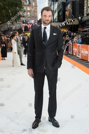 Costa Ronin poses for photographers upon arrival at the UK premiere of Once Upon A Time in Hollywood, in London