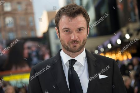 Stock Picture of Costa Ronin poses for photographers upon arrival at the UK premiere of Once Upon A Time in Hollywood, in London