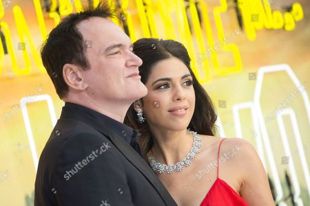 Quentin Tarantino, Daniela Pick. Writer and director Quentin Tarantino and his wife Daniela Pick pose for photographers upon arrival at the UK premiere of Once Upon A Time in Hollywood, in London