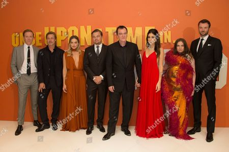 Brad Pitt, Margot Robbie, Leonardo DiCaprio, Quentin Tarantino, Daniela Pick, Lena Dunham, Costa Ronin. From left, actors Brad Pitt, Margot Robbie, Leonardo DiCaprio, director Quentin Tarantino and his wife Daniela Pick and actors Lena Dunham and Costa Ronin, pose for photographers upon arrival at the UK premiere of Once Upon A Time in Hollywood, in London