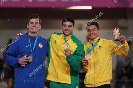 Francisco Barretto (C) of Brazil, gold medal; Robert Neff (C) of the United States, silver, and Carlos Calvo (R) of Colombia, bronze, pose during awards ceremony for the horse test with arches at the artistic gymnastics events, at the 2019 Pan American Games, in Lima, Peru, 30 July 2019.