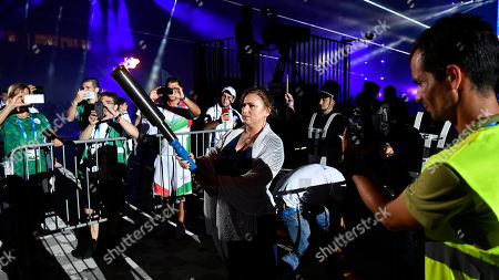 Stock Image of Hungarian chess grandmaster Judit Polgar prepares to light the torch during the opening ceremony of the European Maccabi Games in Budapest, Hungary, 30 July 2019. The European Maccabi Games is the largest Jewish community event in Europe, therefore, there will be many cultural and community programs during the 10 days from 29 July until 07 August. Some 2300 athletes will compete from 42 countries in 24 different sports.