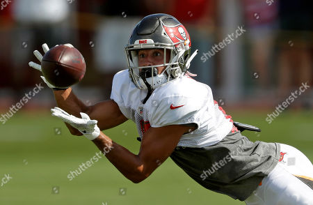 Tampa Bay Buccaneers wide receiver Scott Miller (10) makes a catch during an NFL football training camp practice, in Tampa, Fla