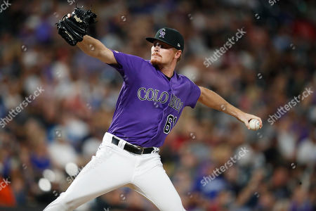 Stock Picture of Sam howard, r m. Colorado Rockies relief pitcher Sam Howard works against the Los Angeles Dodgers during the sixth inning of a baseball game, in Denver