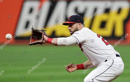 Cleveland Indians' Jason Kipnis fields a ball hit by Houston Astros' Josh Reddick in the sixth inning of a baseball game, in Cleveland. Reddick was out on the play