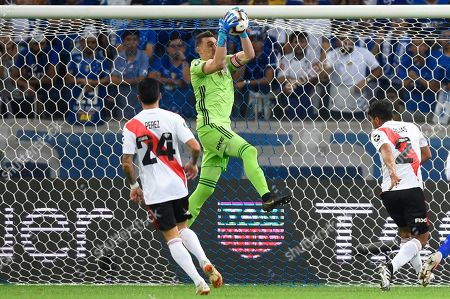 Franco Armani, goalkeeper of Argentina's River Plate, catches the ball during a Copa Libertadores soccer match against Brazil's Cruzeiro, in Belo Horizonte, Brazil