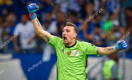 Goalkeeper Franco Armani of Argentina's River Plate celebrates after blocking a penalty during a Copa Libertadores soccer match against Brazil's Cruzeiro, in Belo Horizonte, Brazil