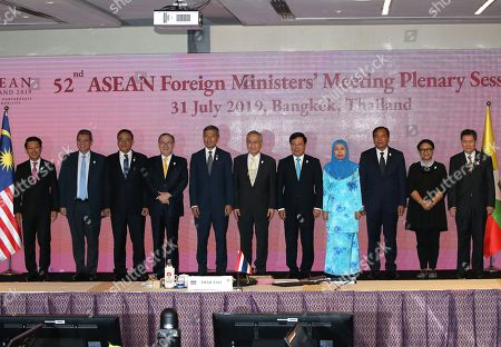 Stock Image of ASEAN Foreign Ministers (L-R) Laos' Foreign Minister Saleumxay Kommasith, Malaysia's Foreign Minister Saifuddin Abdullah, Myanmar's Union Minister for International Cooperation U Kyaw Tin, Philippines' Secretary of Foreign Affairs Teodoro Locsin, Singapore's Foreign Minister Vivian Balakrishnan, Thailand's Minister of Foreign Affairs Don Pramudwinai, Vietnam's Foreign Minister Pham Binh Minh, Brunei's Permanent Secretary of Ministry of Foreign Affairs Dayang Emaleen Abdul Rahman Teo, Cambodia's Minister of Foreign Affairs and International Cooperation Prak Sokhonn, Indonesia's Foreign Minister Retno Marsudi and ASEAN Secretary-General Lim Jock Hoi pose for a group photo during the 52nd ASEAN Foreign Ministers' Meeting Plenary Session in Bangkok, Thailand, 31 July 2019. The 52nd ASEAN Foreign Ministers' Meeting and related meetings is being hosted in the Thai capital from 29 July to 03 August 2019.