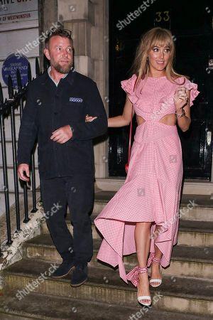 Guy Ritchie and Jacqui Ainsley leaving the Once Upon a Time In Hollywood Premiere afterparty in Pimlico