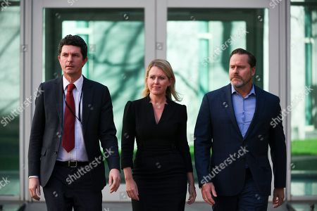 Julian Assange's London-based lawyer Jennifer Robinson (C) prepares for a press conference during a press conference at Parliament House in Canberra, Australia, 31 July 2019. Robinson was in Canberra to brief politicians on Julian Assange current legal situation.