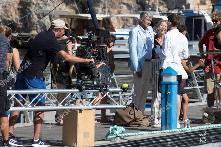 Stock Image of German actors Gerrit Klein (2-R), Petra Zieser (3-R), Dietrich Adam (4-R), and director Stefan Bartman (2-L) are seen during the filming of the German TV series 'Kreuzfahrt ins Glueck' (lit. cruise to happyness) in the port in Ciutadella, Menorca, Spain, 31 July 2019. The filming has been going on in Menorca for 15 days between Calefonts, Cala Mitjana, Sant Lluis, Cala Sant Esteve, Cavalleria and Fornells.