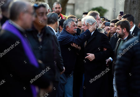 Uruguay's President Tabare Vazquez is embraced by a follower as he enters the cemetery to attend the burial of his wife María Auxiliadora Delgado, in Montevideo, Uruguay, . Uruguay's presidency confirmed that Delgado died of a heart attack during the early morning hours