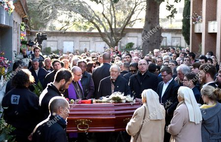 Uruguay's President Tabare Vazquez and his family attend the burial of his wife Maria Auxiliadora Delgado in Montevideo, Uruguay,. Uruguay's presidency confirmed that Delgado died of a heart attack during the early morning hours
