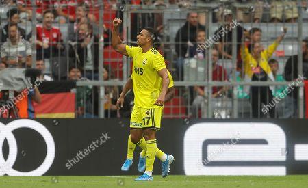 Nabil Dirar of Fenerbahce celebrates scoring a goal to make the score 2-2