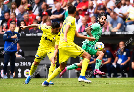 Real Madrid's Isco (R) in action against Fenerbahce players Ozan Tufan (L) and Diego Reyes (C) during the Audi Cup third place soccer match between Real Madrid and Fenerbahce Istanbul in Munich, Germany, 31 July 2019.