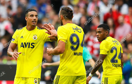 Fenerbahce's Nabil Dirar (L) celebrates with his teammates after scoring the 2-2 equalizer during the Audi Cup third place soccer match between Real Madrid and Fenerbahce Istanbul in Munich, Germany, 31 July 2019.