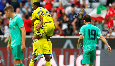 Fenerbahce's Nabil Dirar (2-L) celebrates with his teammate Garry Rodriques (C) after scoring the 2-2 equalizer during the Audi Cup third place soccer match between Real Madrid and Fenerbahce Istanbul in Munich, Germany, 31 July 2019.