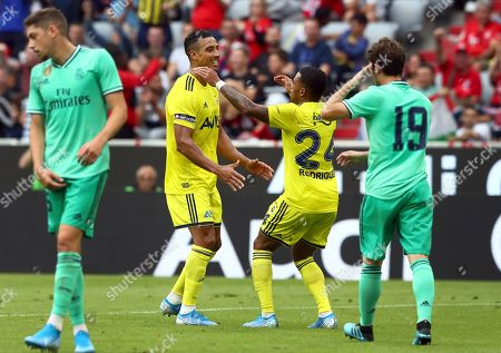 Fenerbahce's Nabil Dirar, 2nd left, celebrates after scoring his side's 2nd goal during the friendly soccer Audi Cup match between Real Madrid and Fenerbahce Istanbul at the Allianz Arena stadium in Munich, Germany
