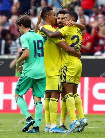 Fenerbahce's scorer Nabil Dirar, 2nd left, and his teammates celebrate their side's 2nd goal during the friendly soccer Audi Cup match between Real Madrid and Fenerbahce Istanbul at the Allianz Arena stadium in Munich, Germany
